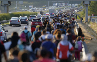 Thousands of Syrian refugees march from Budapest, Hungary towards the Austrian border. Photo credit: Laszlo Balogh / Reuters.